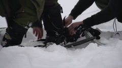 Fitness - winter sports, fitting snowshoes Stock Footage