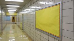 Empty school hallway with bulletin board Stock Photos