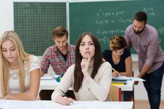 young female students studying in the classroom - stock photo