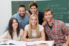 Group of young male and female students Stock Photos