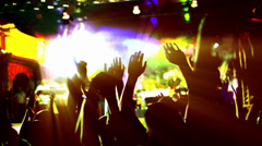 People hands up silhouette backlit and colorful lights on concert. Stock Footage