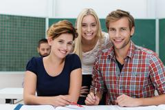 smiling university students - stock photo