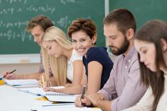 Smiling young woman in the classroom Stock Photos