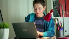 Young boy with modern laptop computer in home HD - stock footage