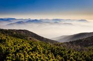 Stock Photo of misty mountains landscape view