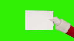 Santa Claus Presenting a White Sheet then sending a Kiss and saying Bye, Green Stock Footage
