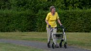 Stock Video Footage of pensioner walk and watch with rollator 11082