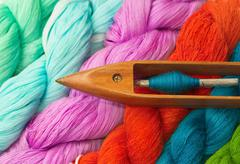 Colorful raw thread and wooden bobbin Stock Photos