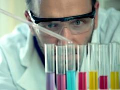 Male scientist doing lab test with chemicals NTSC Stock Footage