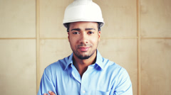 Happy foreman with arms folded at building site inspection Stock Footage