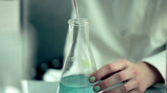 Scientist doing experiment with chemicals in lab HD Stock Footage