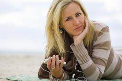 Woman listening to music on the beach Kuvituskuvat