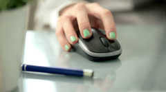 Woman hand using wireless mouse on reflective table HD - stock footage