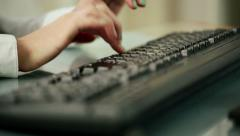 Closeup shot of woman fingers typing on keyboard HD Stock Footage