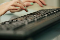 Closeup shot of woman fingers typing on keyboard NTSC Stock Footage