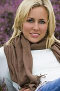Beautiful woman amongst the heather Stock Photos