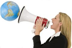 woman with megaphone announcing to the world - stock photo