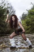 Beautiful young strong hunter warrior woman Stock Photos