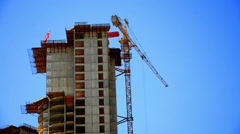 Construction Site, Crane is lifting material at skyscraper building. Stock Footage