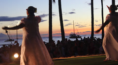 HULA DANCERS HAWAII DURING SUNSET AT WAKIKI BEACH OAHU HD Stock Footage