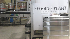 A keg moves along the conveyor at a brewery - stock footage