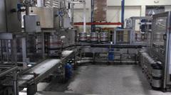 A Keg of Beer on a conveyor belt - stock footage