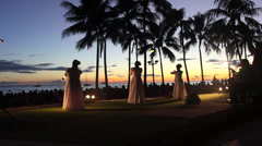 HULA DANCERS IN HAWAII DURING SUNSET AT WAKIKI BEACH OAHU HD Stock Footage
