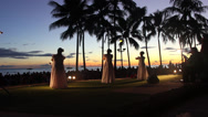 Stock Video Footage of HULA DANCERS IN HAWAII DURING SUNSET AT WAKIKI BEACH OAHU HD