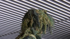 Soldier wearing ghillie suit Stock Footage