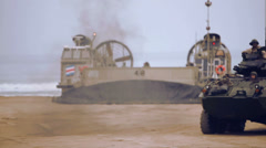 LAV-25 leaving Hovercraft - 02 Stock Footage