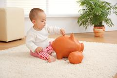 little boy's early savings - stock photo