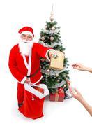 Santa Claus giving a gift Stock Photos