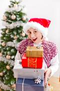 Girl with Christmas presents Stock Photos