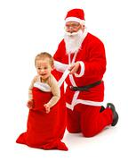 boy in santa claus's bag - stock photo