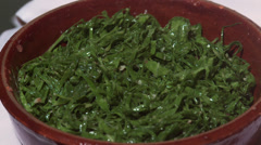 Stir-fried collards, side dish of traditional brazilian food Feijoada Stock Footage