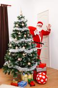 Santa Claus looking back and greeting - stock photo