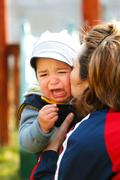 Little crying boy Stock Photos