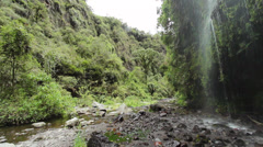 Waterfall in a cloudforest river valley in the Andes near Quito, Ecuador - stock footage