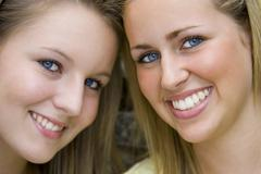 Two young girls smiling best friends Stock Photos