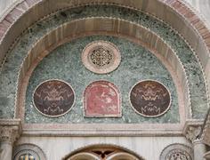 moorish arches on the facade of st. mark's basilica in venice - stock photo