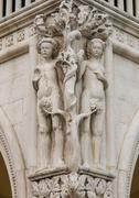 Ornate column capital of adam and eve at doge's palace, venice Stock Photos