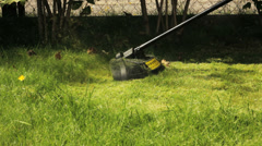 Man cutting grass with lawn mower. Stock Footage