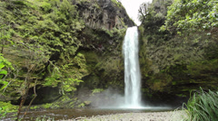 Large waterfall in a cloudforest valley near Quito, Ecuador Stock Footage