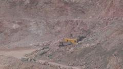 Heavy mining machinery is working in an open pit mine Stock Footage