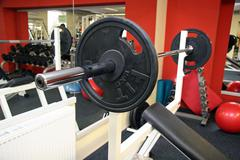 Diverse equipment and machines at the gym room Stock Photos