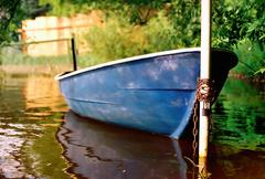 pleasure boat tied to a pole - stock photo