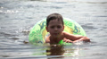 baby floating in rubber ring in the sea Footage