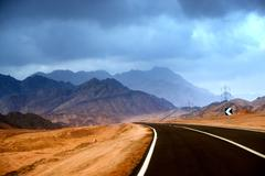 the road in the mountainous desert of the sinai peninsula - stock photo