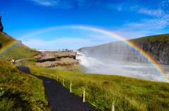 Gullfoss wild waterfall, strong running water and rainbow - stock photo