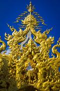 golden sculpture at wat rong khun, the temple at chiangrai province in thaila - stock photo
